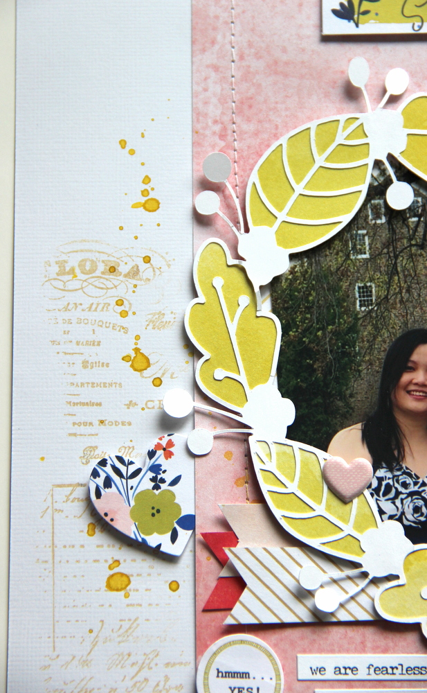 splatters and stamps on scrapbook layout